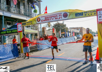2019-TEL-MCL-Semper-Fi-5k-Charity-Run-for-the-Children-Fun-Run-Pensacola-FL_crossing-the-finish-line-first
