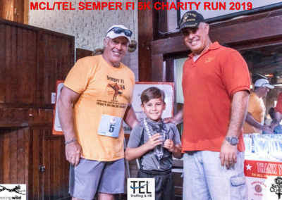 2019-TEL-MCL-Semper-Fi-5k-Charity-Run-for-the-Children-Fun-Run-Pensacola-FL_handing-out-the-awards_TEL-Business-Consultant-Jim-Grant